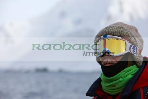 middle aged man wrapped up against the cold on expedition in port lockroy antarctica