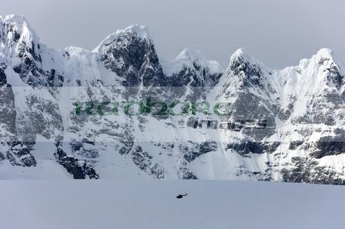 Chilean Navy helicopter on patrol beneath Fief mountain range