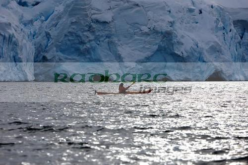 single female sea kayaker near glacier in port lockroy antarctica