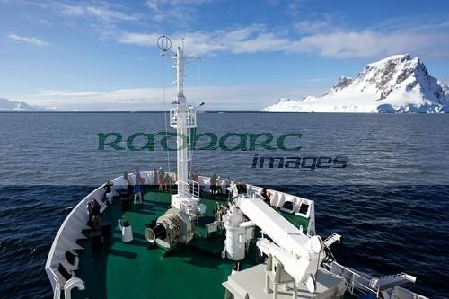 passengers on board ship sailing between anvers island and the antarctic peninsula