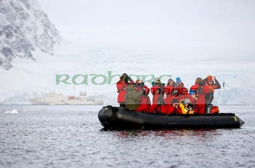 passengers on whale watching expedition from ship in Wilhelmina Bay Antarctica