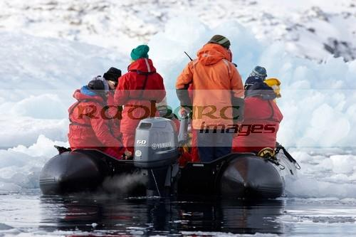 antarctic expedition zodiac boat driving through brash pack sea ice cierva cove antarctica