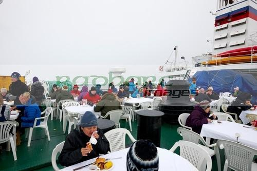 serving bbq lunch passengers on board expedition ship in antarctica