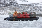 tourists-on-zodiac-excursion-with-engine-trouble-going-through-brash-sea-ice-port-lockroy-antarctica
