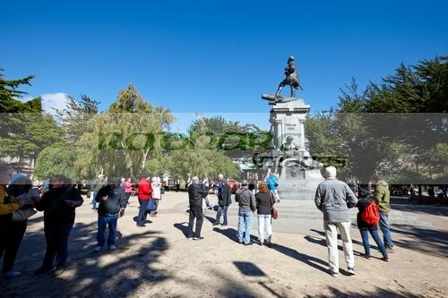 tourists at the Magellan memorial statue in plaza munoz gamero Punta Arenas Chile