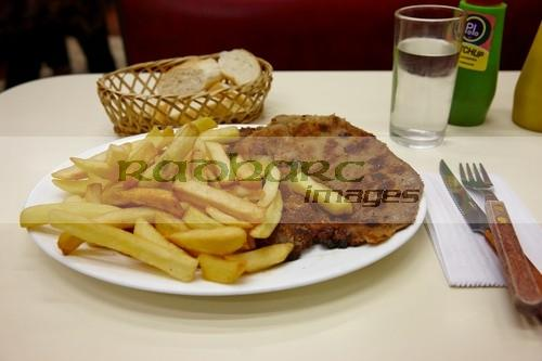 milanesa steak with french fries in a cafe Santiago Chile