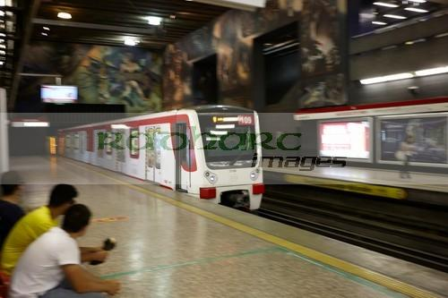 train moving through metro station downtown Santiago Chile deliberate motion blur