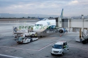 sky-airlines-flight-being-prepared-for-departure-Comodoro-Arturo-Merino-Benitez-International-Airport-Santiago-Chile-shot-through-window