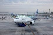 LAN-airlines-aircraft-with-tug-Comodoro-Arturo-Merino-Benitez-International-Airport-Santiago-Chile