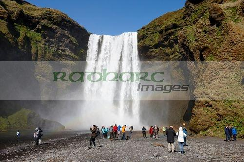 crowds of tourists at skogafoss waterfall in iceland