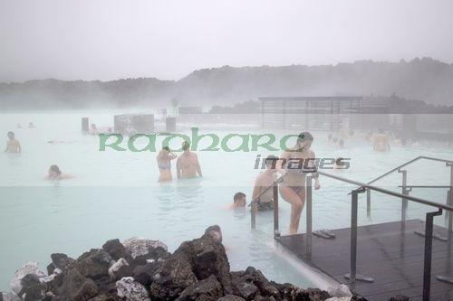 tourists at the blue lagoon spa in misty cold weather Iceland