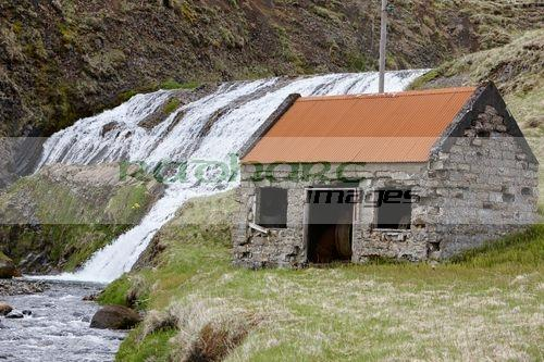former small hydro electric station on a waterfall on a small river in Hlidarendi Hvolsvollur Iceland