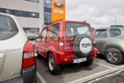 red-suzuki-jimny-jeep-hire-car-at-keflavik-airport-iceland