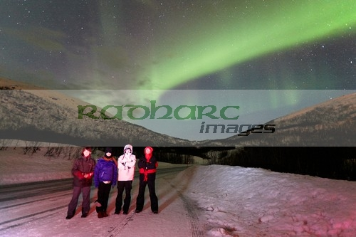 tourists watching northern lights aurora borealis near tromso in northern norway
