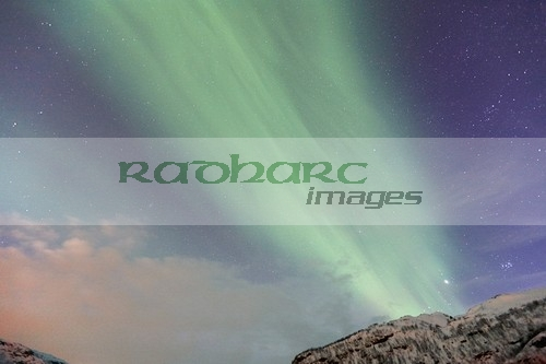thick band of green northern lights aurora borealis near tromso in northern norway