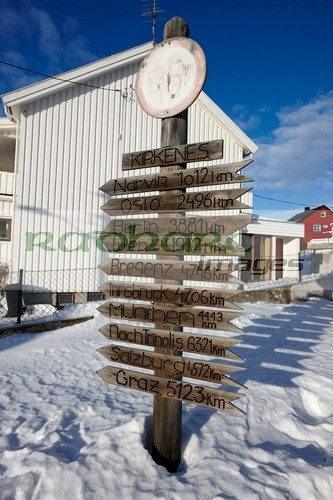 wooden distance marker to various european towns in from kirkenes norway europe