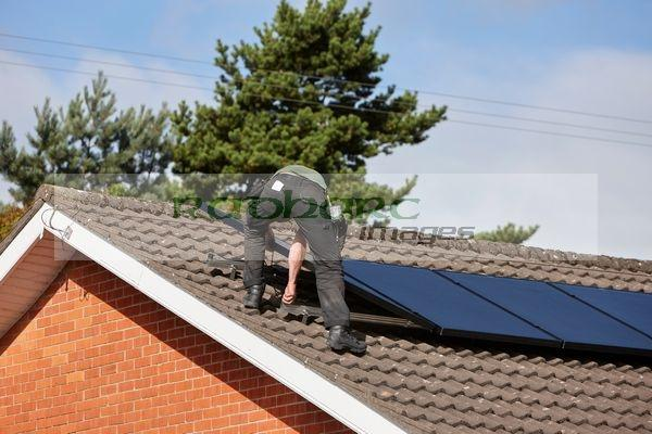 installing solar panels domestic home roof uk photography Joe Fox Belfast northern ireland photographer