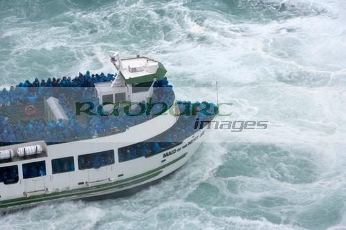 Tourists getting soaked on the Maid of the Mist at Niagara Falls