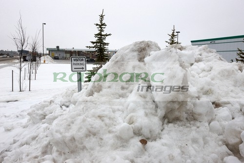 large pile of snow cleared from parking lot