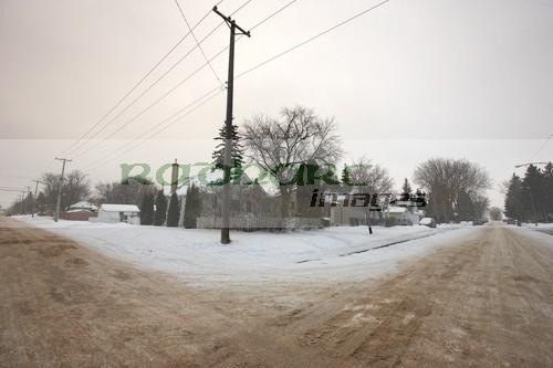 snow covered saskatoon street intersection