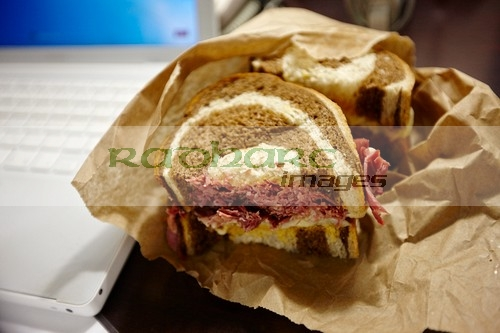 Reuben sandwich with laptop computer