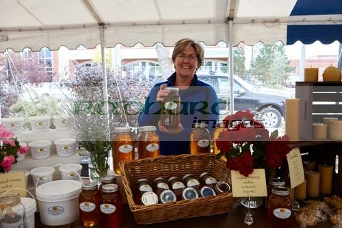 prairie field honey vendor with local produce on sale at a small farmers market in swift current Saskatchewan Canada