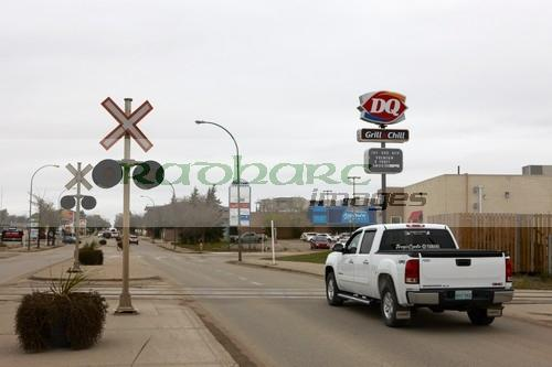 main road and truck crossing railway crossing in downtown weyburn Saskatchewan Canada