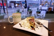 slice-luxury-artisan-sin-cheesecake-with-cup-coffee-in-trees-organic-coffee-house-Vancouver-BC-Canada