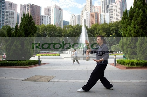 Woman performing Tai Chi in Hong Kong park