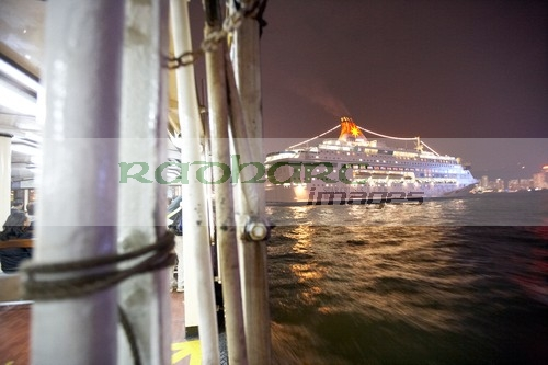 Star ferry crossing Hong Kong harbour at night