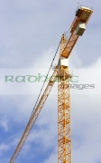yellow-crane-against-blue-cloudy-sky-working-on-construction-site-in-Belfast-City-Centre