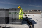 hard-hat-hivis-vest-on-pile-breeze-concrete-building-blocks-on-construction-building-site-in-northern-ireland-uk