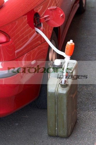 Car and petrol in Jerry Can
