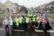 young-schoolchildren-brave-the-rain-for-community-clean-up-project-on-housing-development-in-Belfast