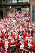 Over-10000-people-dressed-as-santa-claus-walk-through-the-Magazine-Gate-to-attempt-the-Guinness-World-Record-in-Derry-Northern-Ireland
