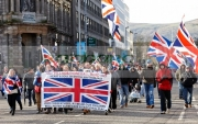 Protesters-from-the-Village-area-Belfast-arrive-at-ongoing-protests-against-Belfast-City-Councils-decision-to-only-fly-the-Union-Flag-on-designated-days.-Belfast-City-Centre,-2nd-February-2013