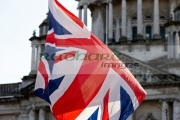 union-flag-held-up-in-front-Belfast-City-Hall-by-protester-at-ongoing-protests-against-Belfast-City-Councils-decision-to-only-fly-the-Union-Flag-on-designated-days.-Belfast-City-Hall,-2nd-February-2013