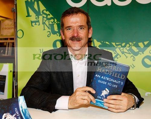 Canadian Astronaut Col Chris Hadfield signs copies of his book 'An Astronauts Guide to Life on Earth