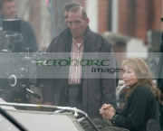 Pete-Postlethwaite-centre-Shirley-MacLaine-during-filming-on-location-for-Sir-Richard-Attenboroughs-latest-film-Closing-the-Ring-in-Belfast,-Northern-Ireland.