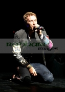 BELFAST,-UNITED-KINGDOM-_-DECEMBER-19:-Chris-Martin-Coldplay-performs-at-Odyssey-Arena-on-December-19,-2008-in-Belfast,-Northern-Ireland.