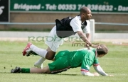 Andy-Abraham-tackled-by-Kieran-McGeeny-at-the-game-history-charity-football-match-at-the-Brandywell-Stadium-Derry-Londonderry-Northern-Ireland-3rd-September-2006