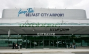 Belfast-City-Airports-new-logo-at-George-Best-airport-renaming-ceremony,-Belfast-City-Airport,-Belfast,-Northern-Ireland.