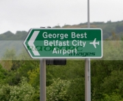 New-roadsigns-bearing-George-Bests-name,-Belfast-City-Airport,-Belfast,-Northern-Ireland.