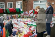 Wellwishers-examine-tributes-for-George-Best-left-in-the-garden-the-Best-family-home,-Cregagh,-Belfast,-Northern-Ireland