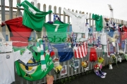 Tributes-for-George-Best-left-on-the-fence-Windsor-Park-soccer-stadium,-Belfast,-Northern-Ireland