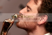 Michael-Fassbender-kisses-his-best-actor-in-feature-film-award-in-the-press-room-at-the-6th-Annual-Irish-Film-Television-Awards-at-the-Burlington-Hotel-on-February-14,-2009-in-Dublin,-Ireland