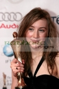 Saoirse-Ronan-with-her-best-actress-in-supporting-role-award-in-the-press-room-at-the-6th-Annual-Irish-Film-Television-Awards-at-the-Burlington-Hotel-on-February-14,-2009-in-Dublin,-Ireland