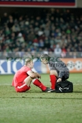 injured-welsh-player-talking-to-physio-at-an-international-friendly-football-match-between-Northern-Ireland-Wales-at-Windsor-Park-6th-February-2006