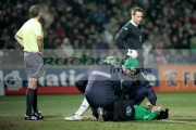 keith-gillespie-lies-injured-receiving-treatment-at-an-international-friendly-football-match-between-Northern-Ireland-Wales-at-Windsor-Park-6th-February-2006