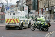 PSNI-police-officers-in-preparation-for-St-Patricks-Day-Parade,-at-St-Patricks-Day-Celebrations,-Belfast-City-Centre.